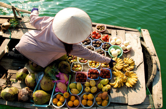Fruit boat seller, Halong Bay, Vietman